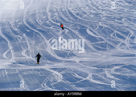 SKIERS ON FROZEN SLOPES IN SUD TIROL ITALY - Stock Photo