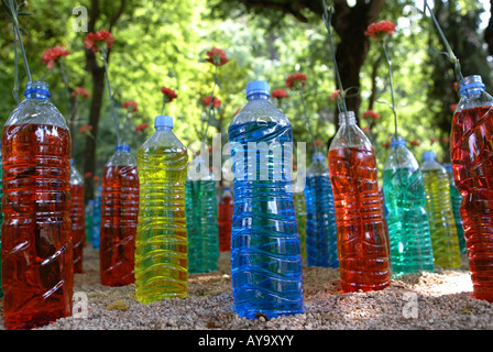 Flowers standing in bottles on display at the Girona flower festival 'Temps de flors', held in May each year, Catalonia, - Stock Photo