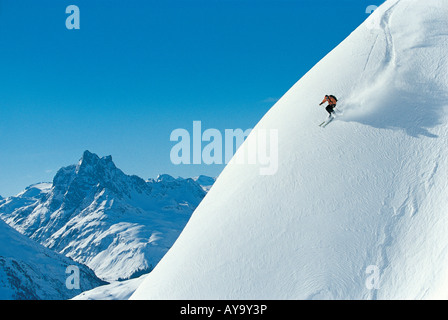 Off piste skier on steep incline, St Anton Am Arlberg, Tyrol, Austria - Stock Photo