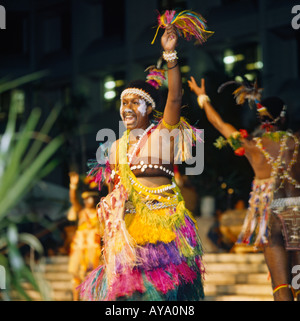 Female dancer of Raun Raun Theatre Group from Papua New Guinea wears colourful dress at the Festival of Pacific - Stock Photo