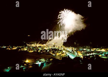 Fireworks in mountain ski resort of Selva di Val Gardena, Italy - Stock Photo