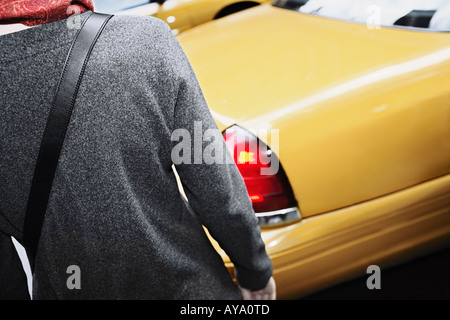 One Woman Catching Taxi Manhattan New York City - Stock Photo