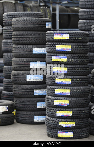 Stacks of new tires - Stock Photo