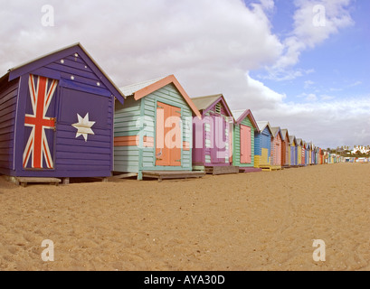 Row of brightly painted bathing huts on Brighton beach Melbourne Australia - Stock Photo