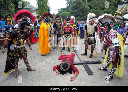 Philippines, easter procession at Moriones Festival on Good Friday. Jesus bearing the cross in the Way of the Cross - Stock Photo