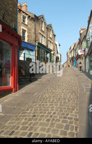 Frome a quaint narrow hilly side streets housing a selection of small shops and eating venues with dwellings above - Stock Photo