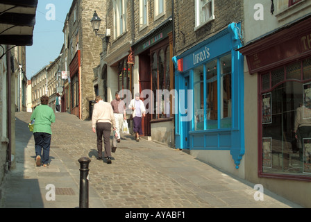 Frome a quaint narrow hilly side street housing a selection of small shops and eating venues with dwellings above - Stock Photo