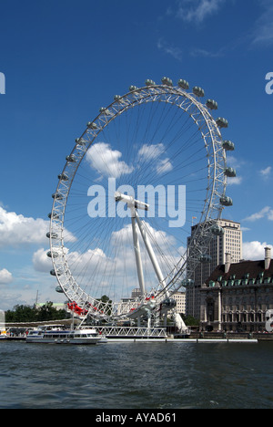 London River Thames at Westminster with British Airways Millennium eye Ferris wheel tour boats and the Shell centre - Stock Photo