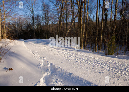 A snowmobile trail in Groton, New Hampshrie. - Stock Photo