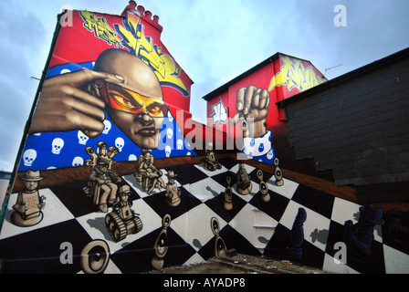 Graffiti art on the gable ends of terraced houses in Brighton - Stock Photo