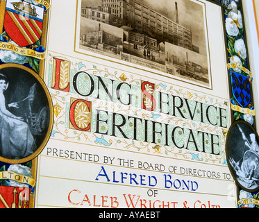 A photo of a long service certificate awarded in 1929 to an employee for working 40 years for the same company. - Stock Photo