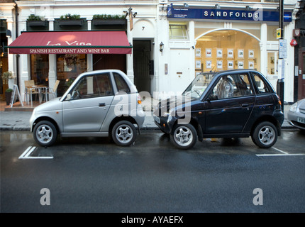 Two cars, one parking space London - Stock Photo