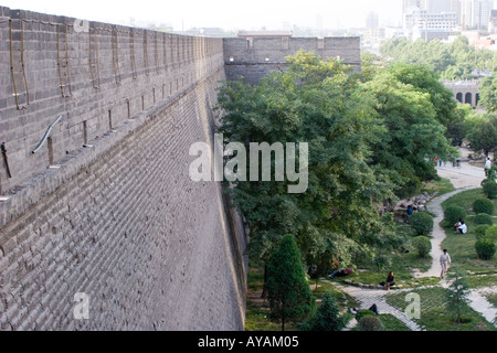 Section of the ancient city inner wall and small city park in Xian (Xi'an) China - Stock Photo