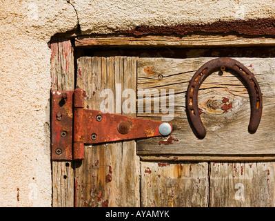 Horse shoe on old wooden door - Stock Photo