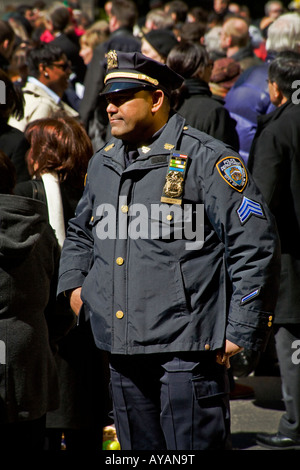 A police sergeant at the Easter Parade on Fifth Avenue in New York City - Stock Photo