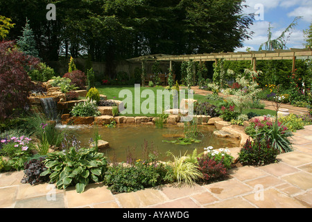 English garden pond with stone surround and aquatic plants for Garden pond specialists