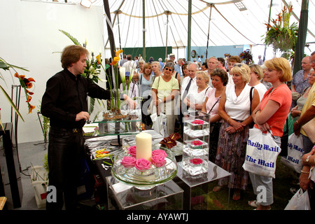 UK Cheshire Knutsford Tatton Hall RHS Flower Show flower arranging demonstration by Mark Entwistle of Black Rose - Stock Photo