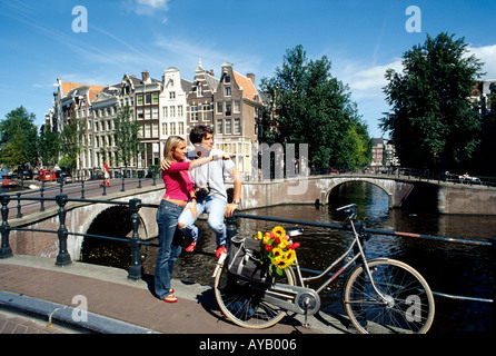 Young couple on holiday in Amsterdam - Stock Photo