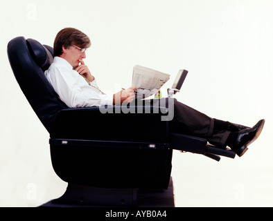 Business Executive travelling sitting in First Class - Stock Photo