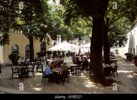 Restaurant in the cool shade of the trees at Monchique - Stock Photo