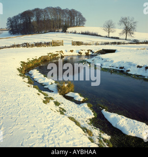 After a nights snow in  a picturesque  cotswold Churn valley  near the village of North Cerney and the  charming - Stock Photo