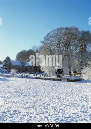 Just like a christmas card  the picturesque church in the cotswold village of North Cerney after a nights snow, - Stock Photo