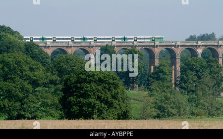 Southern class 377 train passing over a viaduct in the uk - Stock Photo