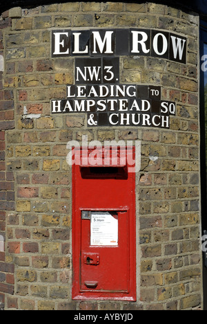 Victorian postbox in a wall at Elm Row Hampstead London - Stock Photo