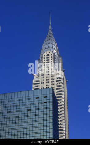 Looking up at the Chrysler Building on 42nd Street in New York City Rockerfeller Center in New York City - Stock Photo