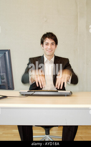 Businessman typing fast - Stock Photo