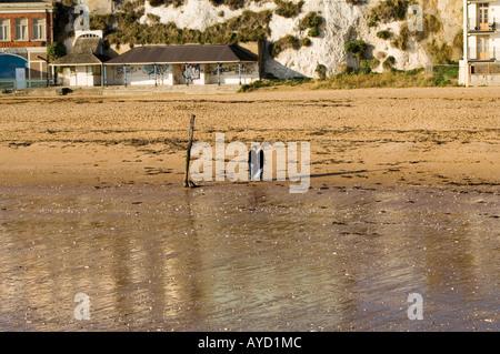 Couple walking on Viking Bay, Broadstairs, Kent, United Kingdom - Stock Photo