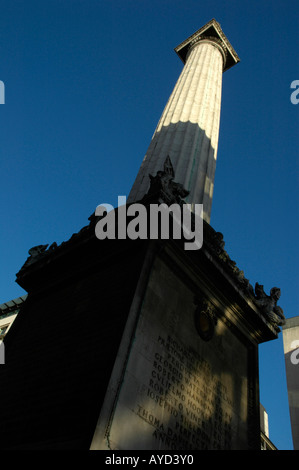 Dramatic view of the Monument commemorating the Great Fire of London viewed from the base City of London - Stock Photo