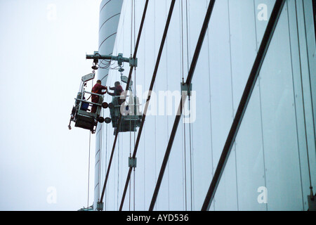 Window cleaning on skyscraper - Stock Photo