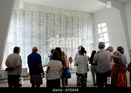 Visitors pay homage at the USS Arizona Memorial Shrine room at Pearl Harbor on the island of O'ahu Hawaii - Stock Photo
