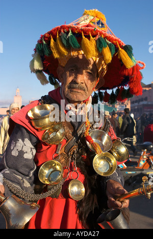 Water seller posing in Place Djemaa el fna Square for a few dinas anyone can take his photo Morocco Africa - Stock Photo