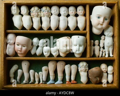 An artfully displayed collection of antique china [bisque] doll parts. - Stock Photo