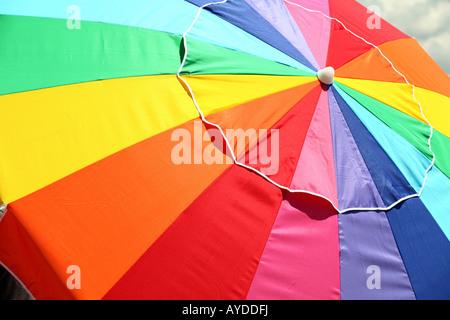 large rainbow colored beach umbrella - Stock Photo