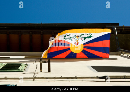 Flag flying from building in Florence, looking directly up. - Stock Photo