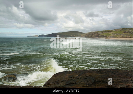waves crashing against a rocky outcrop in Sandwood Bay, Sutherland, Scotland, UK - Stock Photo