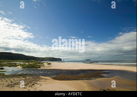 The outflow of Sandwood loch with peat stained water and Sandwood Bay, Sutherland, Scotland, UK - Stock Photo