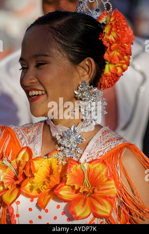 A costumed woman smiling during the Sinulog. - Stock Photo
