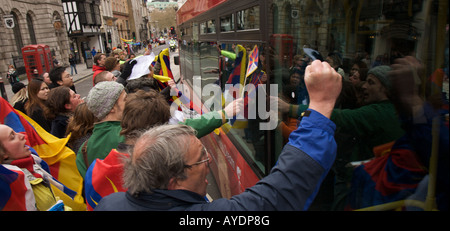 Pro Tibet Beijing 2008 Olympic Torch Relay Protesters Hitting a Bus Containing Chinese Officials - Stock Photo