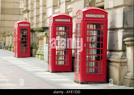 Three K6 standard red telephone boxes adjoining the Birmingham City Council building in Birmingham city centre UK - Stock Photo