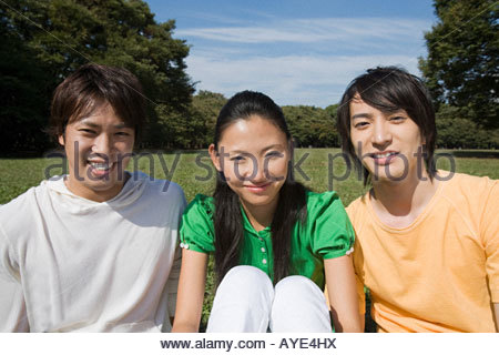 Three friends in park - Stock Photo