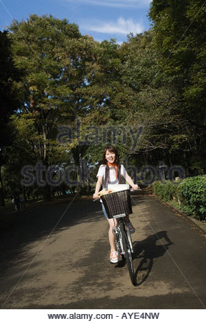 Young woman riding a bicycle - Stock Photo