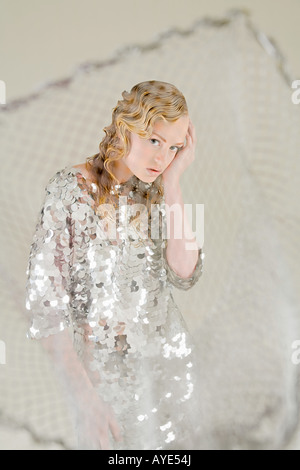 Young woman as fish caught in net - Stock Photo