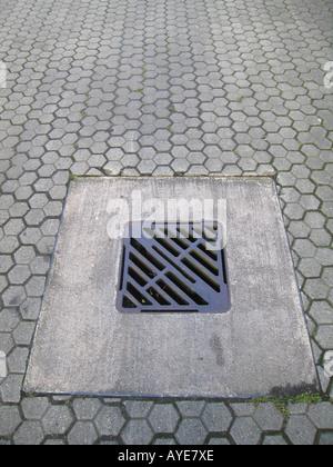 Down the drain concept - Stock Photo