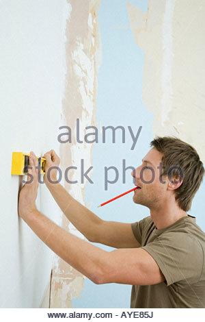 Man using spirit level - Stock Photo