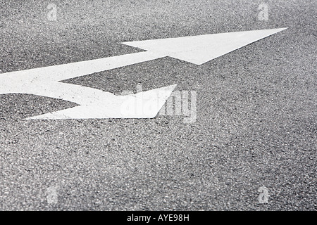 Arrow signs on a road - Stock Photo