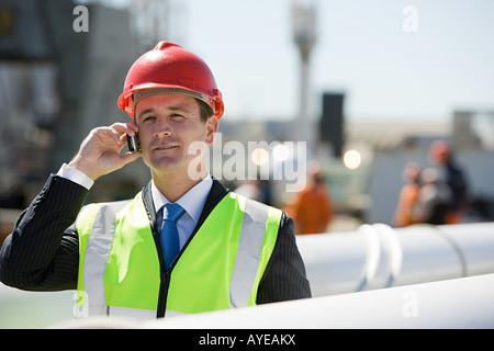 Engineer on cellphone - Stock Photo